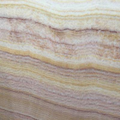 Piedra natural mármol con colores blancos, dorados y tonos cobrizos ONYX TANZANIA